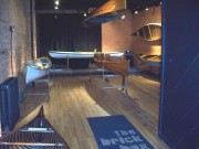 Canoes as Art. Several of my restorations on display in an art gallery.