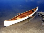 EM White Featherweight Canoe - image 1 of 3 15 ft. wood/canvas canoe. Built in early 1900's in Old Town, ME. Traded for repair work on an antique desk. Very rare. Delicately built. Work included stems, gunwales, some ribs and planking, seats and caning, canvassing and painting.