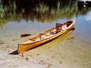 "English Model 20 - image 1 of 2 William English Canoe Co. ""Model 20"" sailing canoe, 16 ft. built in Peterborough, Ont. in early 1900s. Found in late 80s near Portland, ME lying right side up outdoors near a wood pile. Stems were rotted and sides were splayed out with some moss growing inside. Wrapped it in duct tape for trip home. Started restoration, but unable to finish until 1997. Work included new gunwales, stems, some ribs and planking, decks, stripping inside and varnishing inside and out."